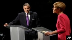 In North Carolina, Republican Senator Richard Burr has sought to capitalize on double-digit Obamacare premium hikes as he tries to retain his seat against Democratic challenger Deborah Ross, who debated Burr, Oct. 13, 2016.