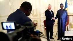 Chad's President Idriss Deby welcomes U.S. Secretary of State Rex Tillerson at the Presidential Palace in N'Djamena, Chad, March 12, 2018.