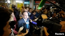 Russian political scientist Vyacheslav Nikonov (C) speaks to journalists after arriving at Sheremetyevo airport in Moscow July 12, 2013.