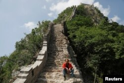 A man rests while working on the reconstruction of the Jiankou section of the Great Wall, in Huairou District, north of Beijing, China, June 7, 2017.