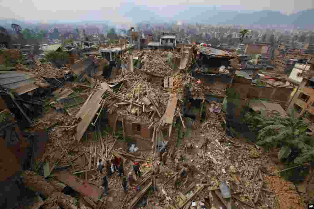 Rescue workers search for victims of earthquake in Bhaktapur near Kathmandu, Nepal, April 26, 2015.