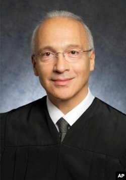 FILE - This undated photo provided by the U.S. District Court shows Judge Gonzalo Curiel.