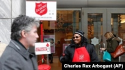 Carolyn Harper collects donations for Salvation Army in Chicago.