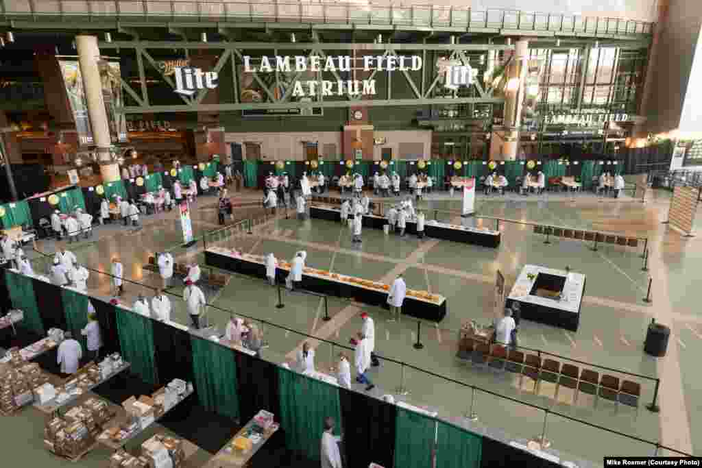 Judging for the U.S. Championship Cheese Contest is held in the atrium of Lambeau Field, Green Bay, Wis., March 5, 2019. The judging is open to the public and visitors watch judges and sample cheeses.