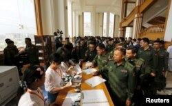 Military members of parliament arrive at the Union Parliament in Naypyitaw, Myanmar, March 15, 2016.