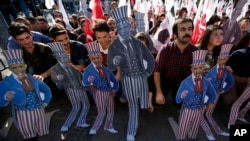 Members of the Turkey Youth Union hold effigies of U.S. President Barack Obama during a protest in Antalya, Turkey, Nov. 15, 2015.