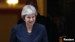 La Première ministre britannique Theresa May sortant du 10 Downing Street à Westminster, Londres, Grande-Bretagne, le 9 juillet 2018.