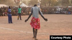 Wrestlers in a camp for war-displaced Nuba struggle to maintain their cultural strength in a documentary film (Courtesy Hajooj Kuka)