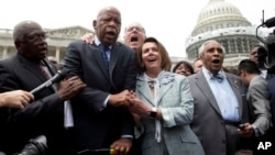 "From left, House Assistant Minority Leader James Clyburn, Rep. John Lewis, D-Ga., Rep. Joseph Crowley, D-N.Y., House Minority Leader Nancy Pelosi of California, and Rep. Charles Rangel, D-N.Y., sing ""We Shall Overcome"" on Capitol Hill, in Washington, June"