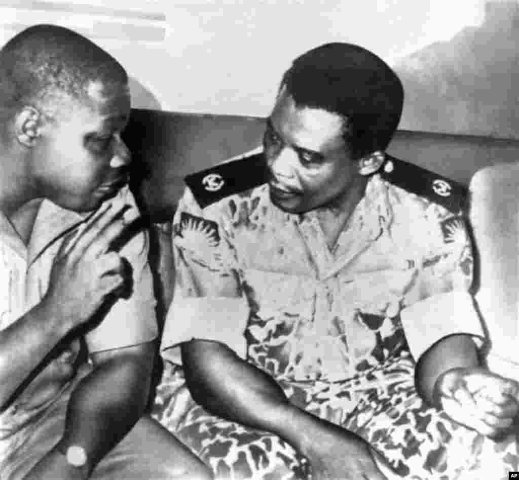 Lt. Col. Philip Effiong, right, acting head of state who announced the formal surrender of Biafra, talks in Owerri, Biafra's last stronghold, to Col. Olusegun Obasanjo, who accepted the field surrender of Biafra's armed forces, Jan. 15, 1970.