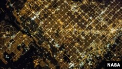 'Super View' of Glendale and Phoenix, Arizona, an image taken by a crew member of the Expedition 35 on the International Space Center. Cities in the image include Phoenix proper (right), Glendale (center), and Peoria (left).