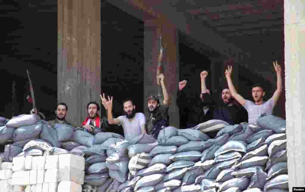 Soldiers loyal to President Bashar al-Assad pose for a photo in Aleppo's main prison, May 22, 2014.