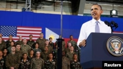 President Barack Obama speaks to military troops at the Fort Bonifacio Gymnasium in Manila, April 29, 2014.