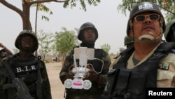 FILE - Cameroonian soldiers operate a surveillance drone at their base in Achigachia, Cameroon, March 16, 2016. An 8,700-strong regional force is seeking to stamp out Boko Haram.