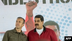 FILE - Venezuelan President Nicolas Maduro, right, and his Vice President Tareck El Aissami participate in a rally in Caracas, Jan. 31, 2017.