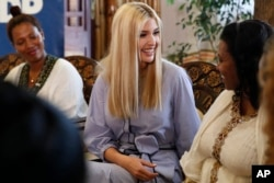 White House senior adviser Ivanka Trump smiles at Azalech Tesfaye, who is the recipient of loan guarantee through USAID, as Trump meets women who work in the Ethiopian coffee industry, Sunday Apr. 14, 2019.