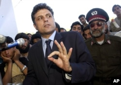 FILE - Then-Presidential candidate Abdul Latif Pedram gestures as he speaks to supporters during a campaign stop at a stadium of western city in Herat, Afghanistan, Oct. 3, 2004.