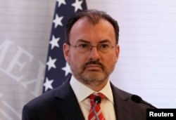 FILE - Mexican Foreign Minister Luis Videgaray listens during a news conference in Mexico City, Mexico, Feb. 2, 2018.