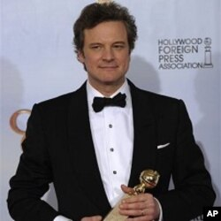"""Colin Firth holds the award for Best Performance by an Actor in a Motion Picture - Drama for his role in """"The King's Speech,"""" at the Golden Globe Awards 16 Jan. 2011, in Beverly Hills, California."""