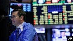 Suasana di Bursa Saham New York (8/7). (AP/Seth Wenig)