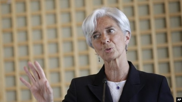 French Finance Minister Christine Lagarde gestures during a press conference, in Paris, May 25, 2011
