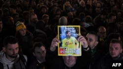 FC Nantes football club supporters gather in Nantes after it was announced that the plane Argentinian forward Emiliano Sala was flying on vanished during a flight from Nantes in western France to Cardiff in Wales, on January 22, 2019.