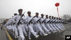 Chinese sailors march during a parade in Qingdao in east China's Shandong province, March 5, 2012.