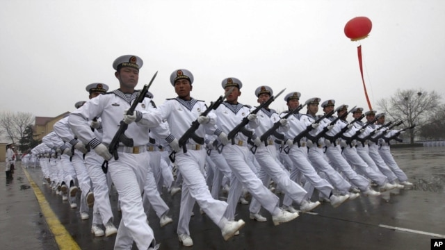Chinese sailors march during a parade at a training base of China's North Sea Fleet in Qingdao in east China's Shandong province on Monday, March 5, 2012.
