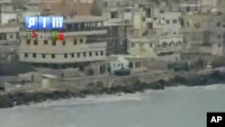 電視畫面顯示﹐敘利亞軍8月14日在拉塔基亞鎮壓