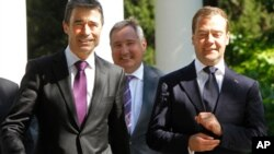Russian President Dmitry Medvedev (R), Russia's ambassador to NATO Dmitry Rogozin (C) and NATO Secretary General Anders Fogh Rasmussen walk together during their meeting in the southern Russian city of Sochi. NATO's chief defended the alliance's Libya ope