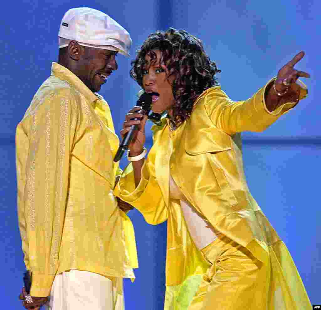 In this May 23, 2003 photo, Whitney Houston, right, and her former husband, Bobby Brown, perform in Las Vegas. Houston died at age 48 on February. 11, 2012. (AP)