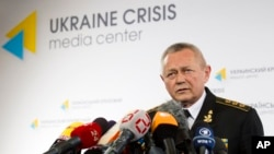 Ukrainian Defense Minister Ihor Tenyukh speaks during a news conference at a hotel in Kiev, March 17, 2014.