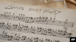 """FILE - An original handwritten song by Lionel Hampton titled """"Hamp's Boogie Woogie"""" is seen at the Colored Musicians Club in Buffalo, New York, Jan. 14, 2005."""