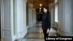 In this June 6, 2019 photo, Joy Harjo, of the United States, poses inside the Library of Congress, in Washington. Harjo has been named the country's next poet laureate, becoming the first Native American to hold that position. (Shawn Miller/Library of Congress)