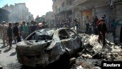 Hiện trường vụ đánh bom xe tại khu phố al-Abassia trong thành phố Homs, ngày 29/4/2014.