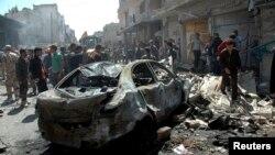 시리아 중부 도시 홈스에서 29일 차량폭탄 공격으로 최소한 37명이 사망했다. 시리아 관영 '사나' 통신이 배포한 사진이다.