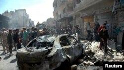 Serangan bom mobil di kota Homs, Suriah akhir bulan lalu (foto: dok). 29 orang tewas dalam serangan bom mobil dekat perbatasan Turki, Kamis (15/5).