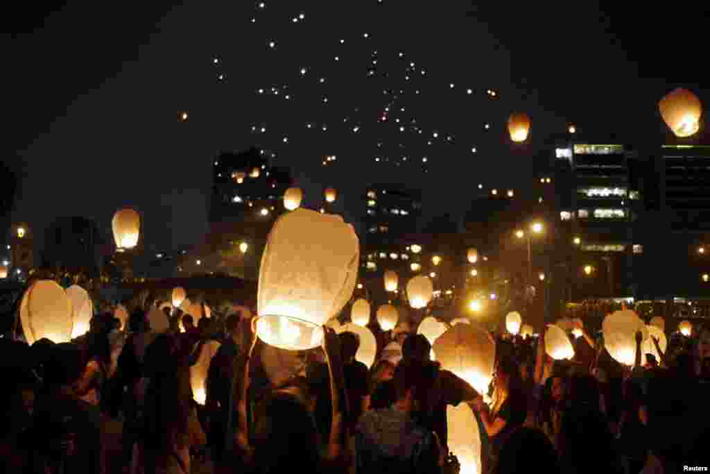 People release sky lanterns during the Lebanon Lantern Festival in Beirut, June 13, 2015.