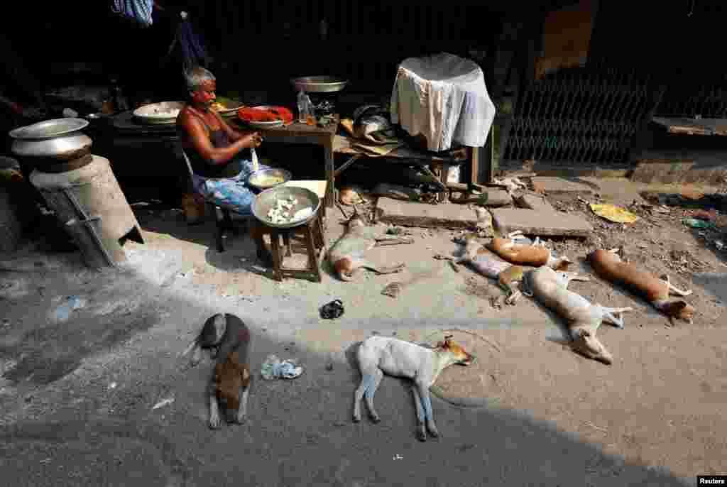 A man prepares food at a roadside shop in Kolkata, India.