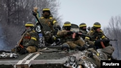 Members of the Ukrainian armed forces in armoured personnel carrier near Debaltseve, eastern Ukraine, Feb. 10, 2015.