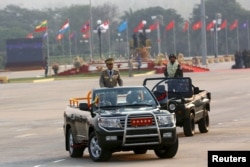 Commander-in-chief Min Aung Hlaing rides on a vehicle during a parade to mark Armed Forces Day in Myanmar's capital Naypyitaw, March 27, 2016.