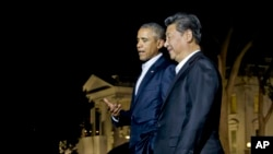 President Barack Obama and Chinese President Xi Jinping, right, walk on the North Lawn of the White House in Washington, Thursday, Sept. 24, 2015.