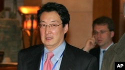 FILE - Victor Cha, at the time the U.S. National Security Council's director for Asian Affairs in the George W. Bush White House, is seen walking through a hotel lobby in Beijing, China, March 22, 2007. Cha is reportedly under consideration for the post of U.S. ambassador to Seoul.