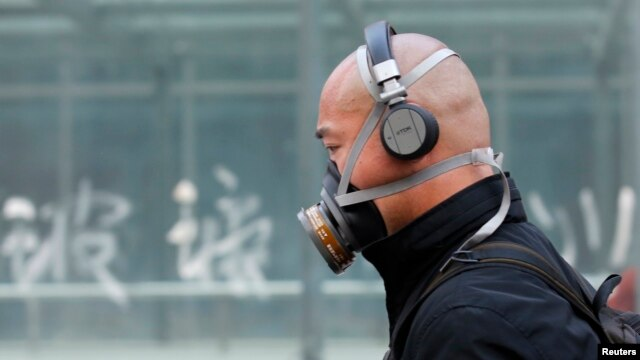 A man wearing a mask is seen on a street in Beijing, May 2, 2013.