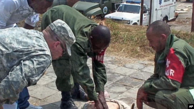 Soldiers from the Congolese army medical personnel train as soldiers from Africom, the US military command covering Africa, oversee them during a two-weelk training exercise in Kinshasa, the capital of the Democratic Republic of Congo, Oct 2010