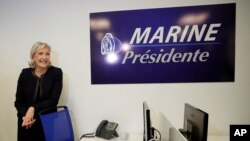 Trump effect and French elections: Far-right leader Marine le Pen poses as she inaugurates her campaign headquarters, Wednesday, Nov.16, 2016 in Paris. Le Pen is convinced that her anti-immigration, anti-Islam views can lead her to the presidency in five