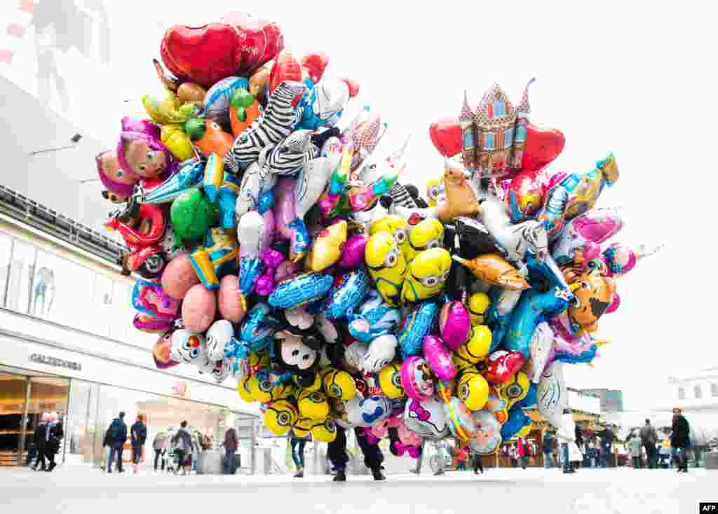 A man sells balloons in the city center of Hanover, central Germany.