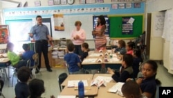 Junior Achievement brings business people to classrooms to share their experiences with students