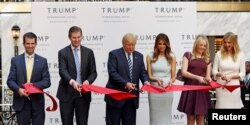 (L-R) Donald Trump Jr., Eric Trump, then-Republican U.S. presidential nominee Donald Trump, Melania Trump, Tiffany Trump and Ivanka Trump attend an official ribbon-cutting ceremony at the new Trump International Hotel in Washington D.C., Oct. 26, 2016.