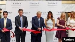 FILE - Donald Trump Jr., Eric Trump, then-Republican U.S. presidential nominee Donald Trump, Melania Trump, Tiffany Trump and Ivanka Trump attend an official ribbon cutting ceremony at the new Trump International Hotel in Washington, Oct. 26, 2016.